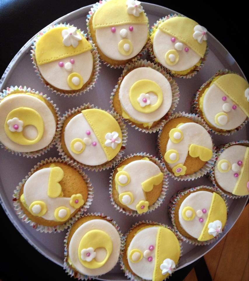 Baby shower vanilla cupcakes with a strawberry slap